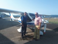 Posing by the light aircraft