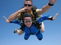 Sending a kiss while skydiving