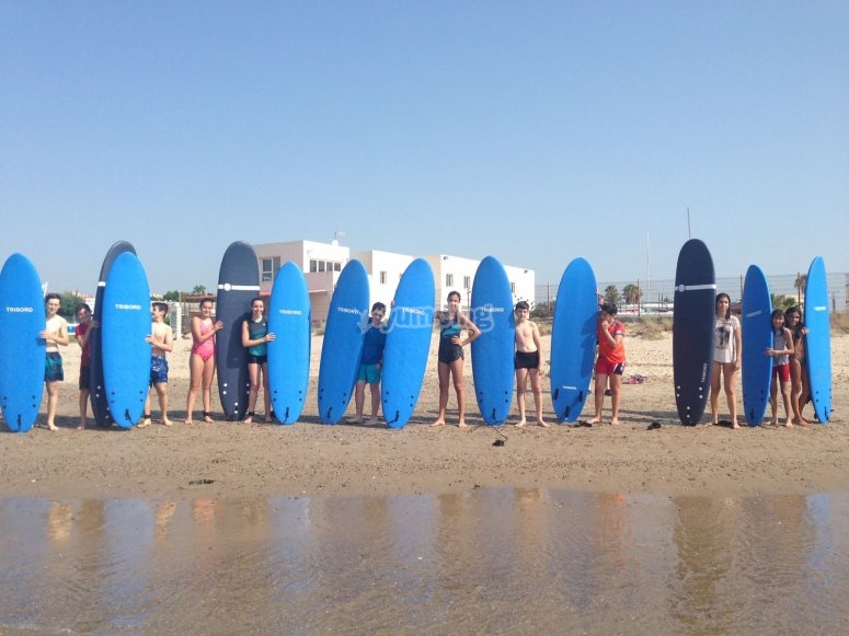 Surfers group with the boards