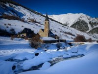Church and frozen river