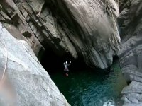 Spectacular jump to the ravine pool