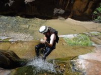 Abseiling down to the riverbed