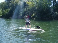 Paddle surfing in the sun