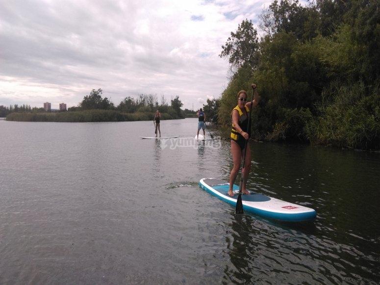 Paddle surfing in Fluvia River