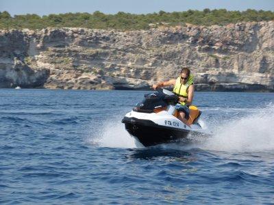 Puesta de sol en moto de agua costa menorquina
