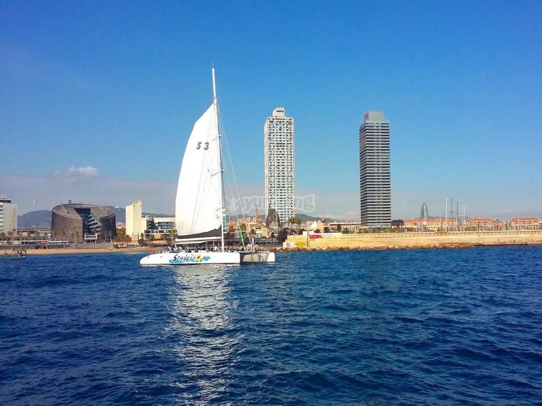 Catamaran with the Barcelona skyline