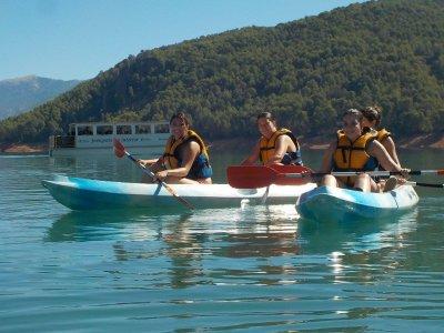 Kayaking in rough water by Guadalquivir river