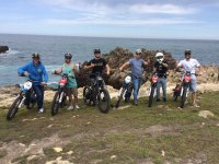 With the motorcycles and the sea behind
