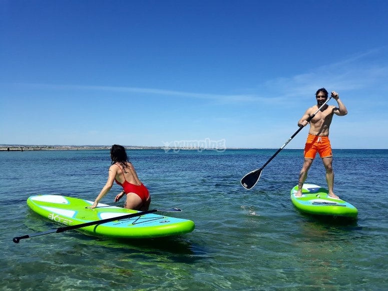 Paddle surf with children