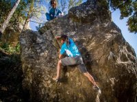 climbing a natural rock without harnesses