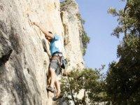 young man practicing climbing