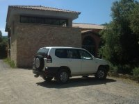 4x4 in front of a stone house
