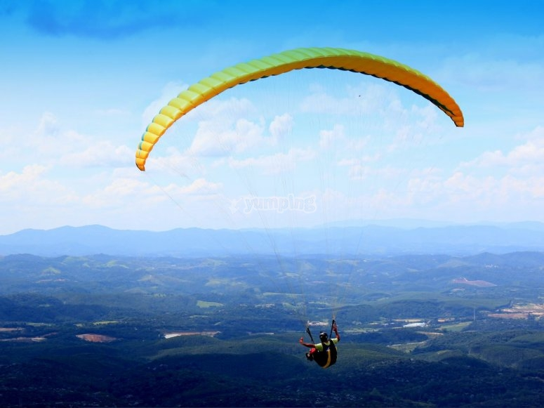 paragliding over the green sights
