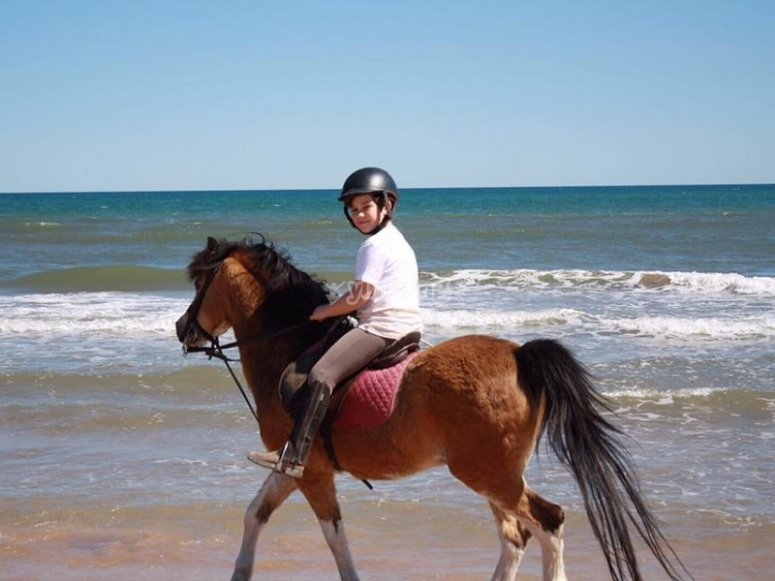Riding a pony in the beach of Gandia