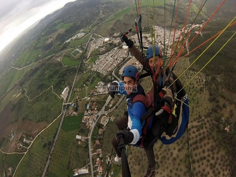 Waving at the camera from the paraglider