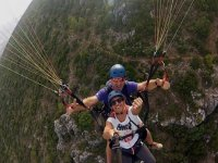 Flying on the paraglider through the mountains of Cádiz