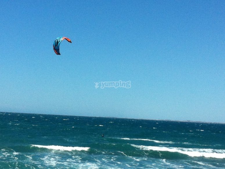 Flying kite in the sea