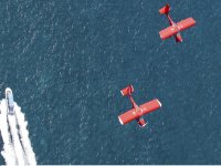 Airplanes flying in parallel on ship