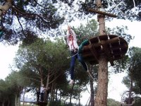 boy jumping on zip line