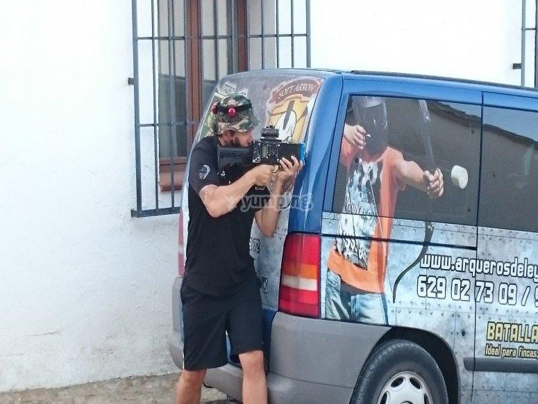 Taking cover behind the van