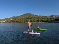 Kayak junto a tabla de SUP