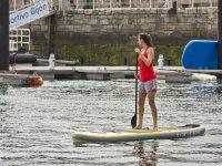 Corso di paddle surf sulla spiaggia di Gijón Poniente