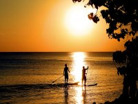 Sunsets while practicing paddle surfing
