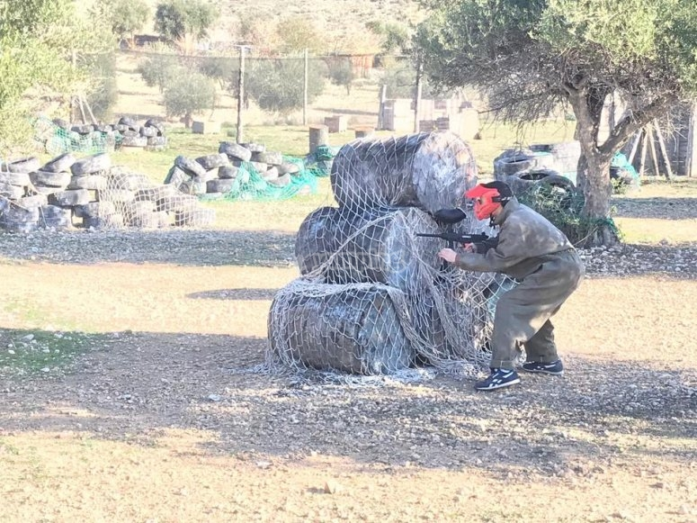 Aiming at the enemy in the game of paintball