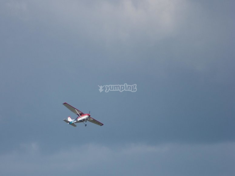 Flying over the skies of Pontevedra on the ligh aircraft