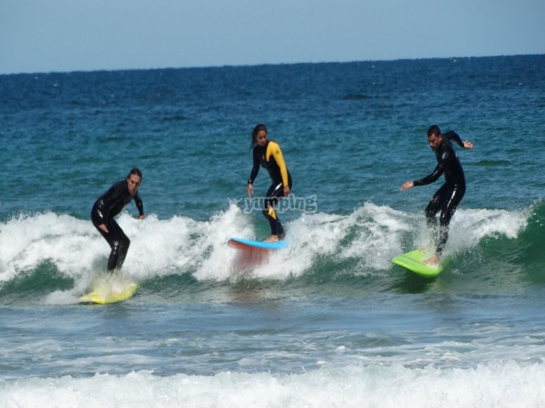 Surfing with two other persons