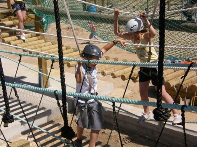 Holding tight the bridge ropes