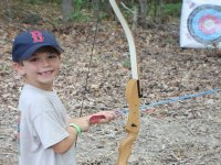 Kid shooting with the bow