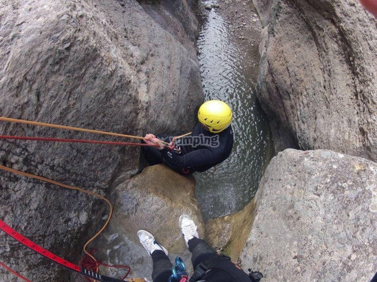 Rapelling in the canyon