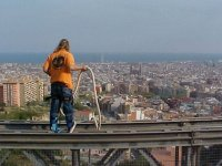 Bungee jumping over the skyline of the city of Barcelona