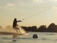 With water skis at sunset