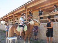 Riding a horse in the school farm