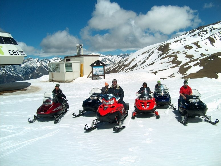 Friends in snowmobiles