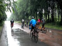 Even if it rains we go by bike