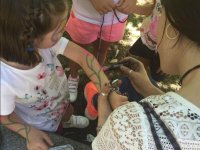 Painting flowers on the arm in Aravaca