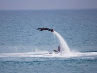 Placing the armas back on the flyboard surfboard