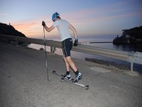 Rollerski with the beach in the background