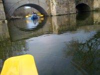 In canoe under the bridge