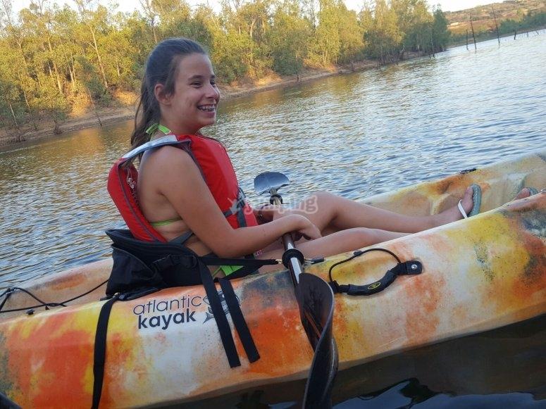 Navigating on kayak through the river