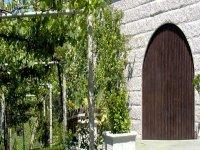 Vineyards next to a wooden door