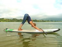 Paddle yoga en la playa