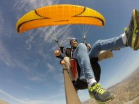 A yellow paraglider