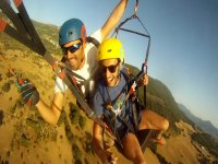 Trying taking turns with the paraglider