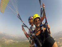 A girl smiling while paragliding