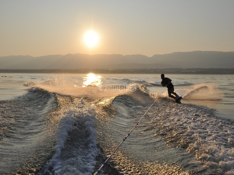 Sailing on a wakeboard by sunset time