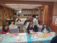 Girls in a craft workshop with doraimon tablecloths